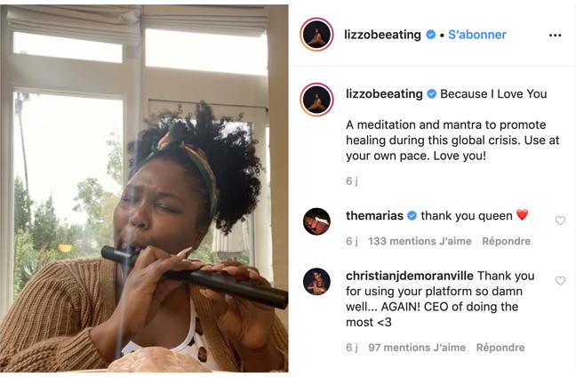 Lizzo playing the flute